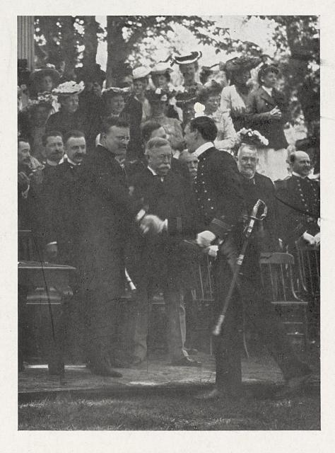 [Cadet shaking hands with President Theodore Roosevelt after receiving his diploma]