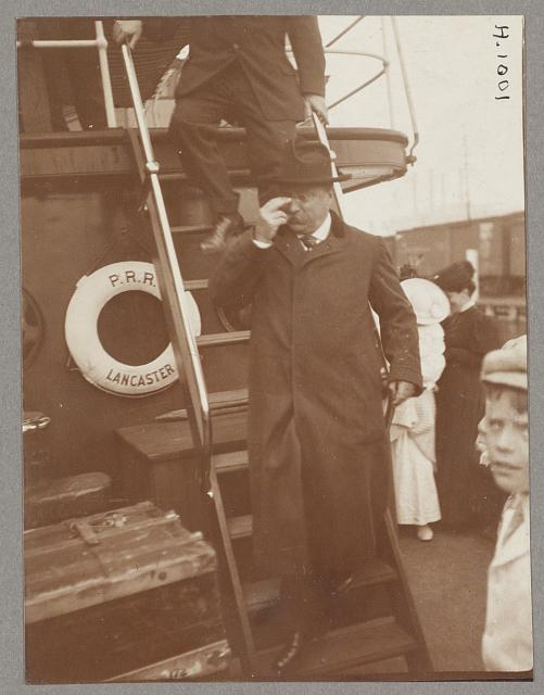 [Theodore Roosevelt, full-length portrait, exiting stairs of ship, facing front]