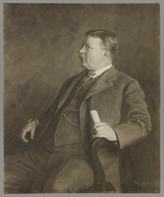 [Theodore Roosevelt, three-quarter view portrait, seated in small armchair with small roll of paper in left hand, turned left]