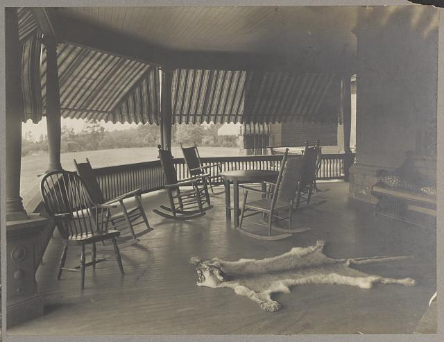 [President Roosevelt's country home, Sagamore Hill in Oyster Bay, New York, view of porch with mountain lion skin on floor]