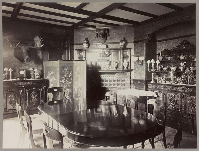 [Dining room in home of Pres. Theodore Roosevelt, Washington, D.C. with moose head and ram's head on walls]
