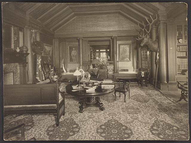 [Trophy room at Sagamore Hill, summer home of President Theodore Roosevelt, with bison and elk heads on wall]