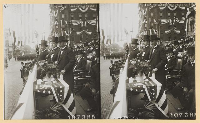 [President Roosevelt with the Governor of Ohio and the Mayor of Canton reviewing parade on McKinley Memorial Day, Canton, Ohio]