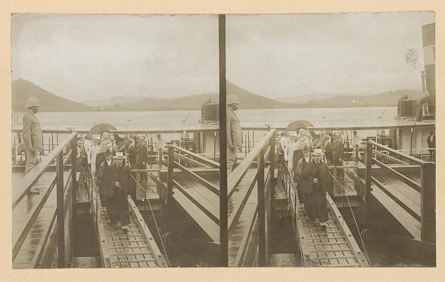 [Theodore Roosevelt and party disembarking from boat]