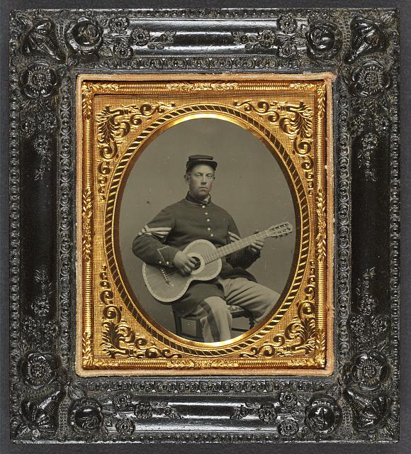 [Edwin Chamberlain of Company G, 11th New Hampshire Infantry Regiment in sergeant&#39;s uniform with guitar]