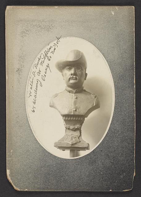[A three-quarter view bust representation of President Roosevelt in uniform of Colonel of Rough Riders, mounted on a pedestal]