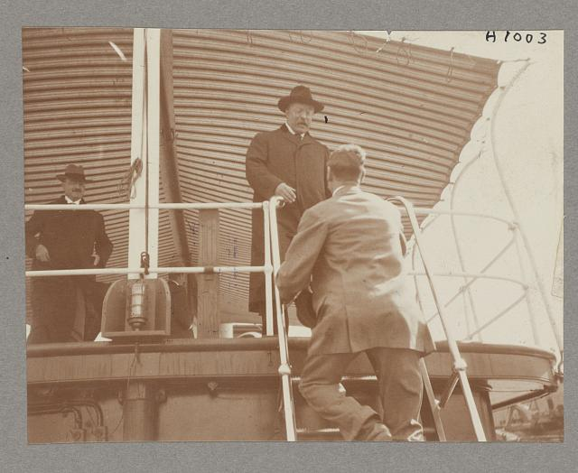 [President Theodore Roosevelt greeting man aboard shipl]