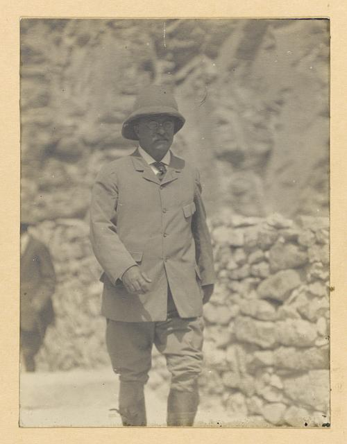 [Theodore Roosevelt walking forward, wearing a pith helmet]