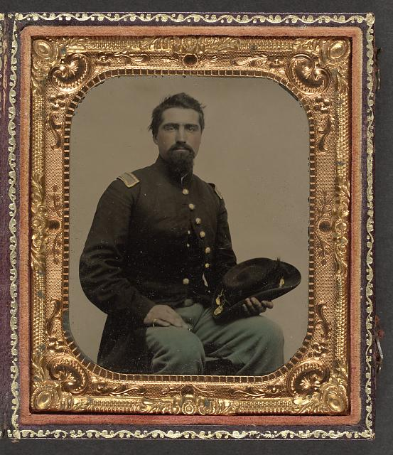 [Unidentified soldier in Union second lieutenant uniform holding hat]