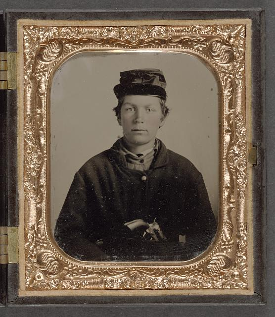 [Unidentified young soldier in Union uniform and forage cap with revolver]