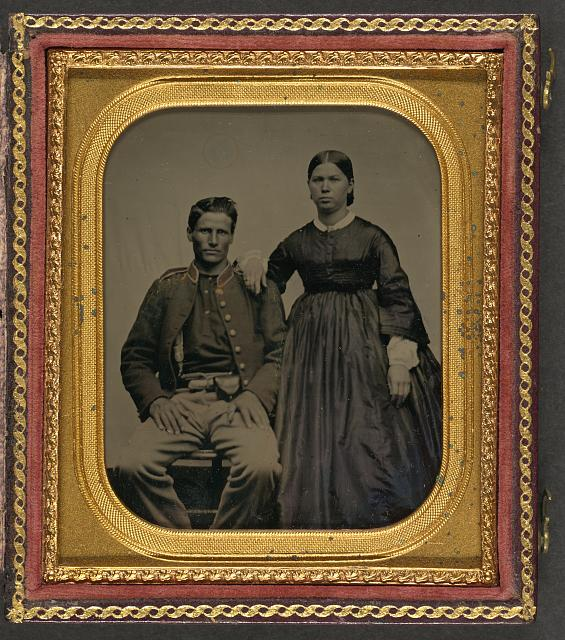 [Unidentified soldier in Union uniform next to unidentified woman]