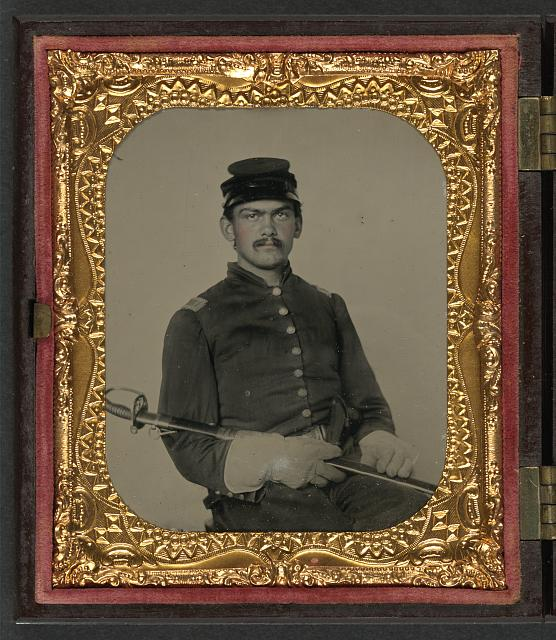 [Unidentified soldier in Union first lieutenant's uniform and gauntlets with field officer's sword]
