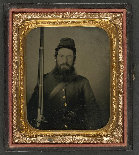 [Unidentified soldier in Union uniform with musket, revolver, and bayonet with scabbard]