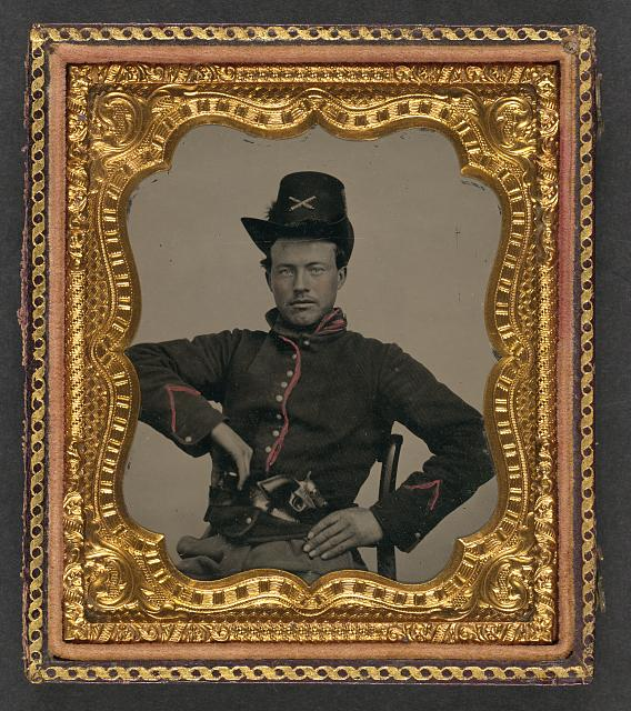 [Unidentified soldier in Union artillery uniform with Hardee hat and revolver]