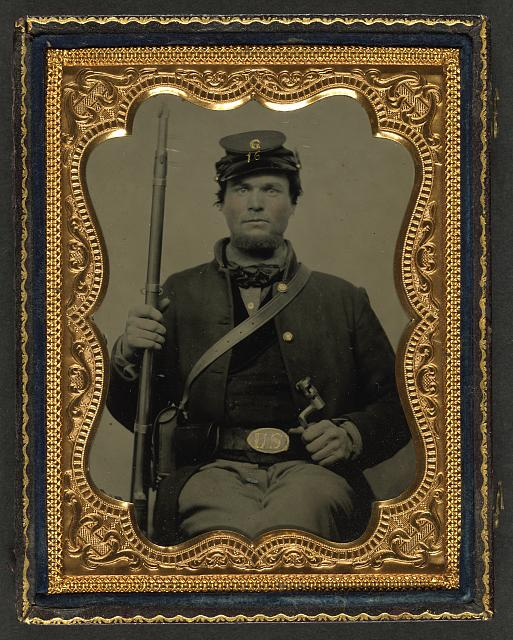 [Private Horace H. Smith of Company G, 16th Wisconsin Infantry Regiment, in forage cap with bayonet, musket, cartridge box, and musket sling etched H. H. Smith]