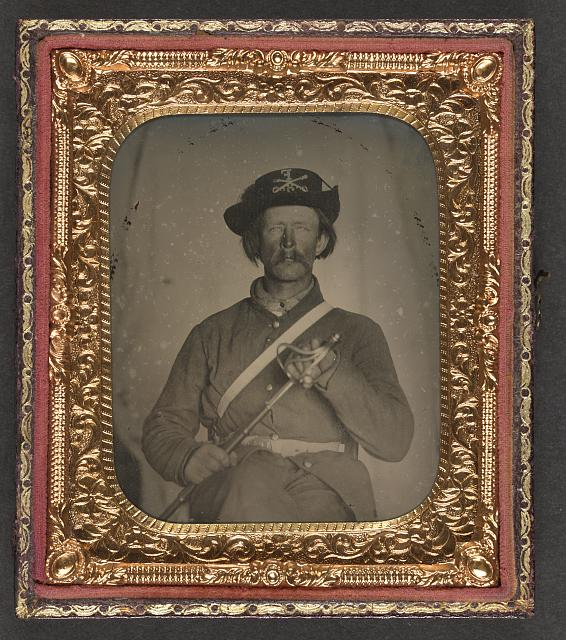 [Unidentified cavalry soldier in Union uniform with Hardee hat holding Model 1858 light cavalry saber]