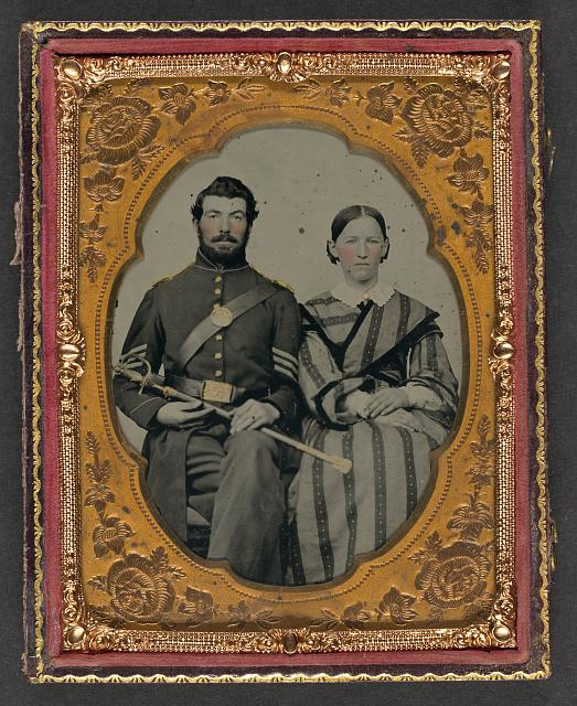 [Unidentified soldier in Union sergeant's uniform with Model 1840 non-commissioned officer's sword next to unidentified woman]