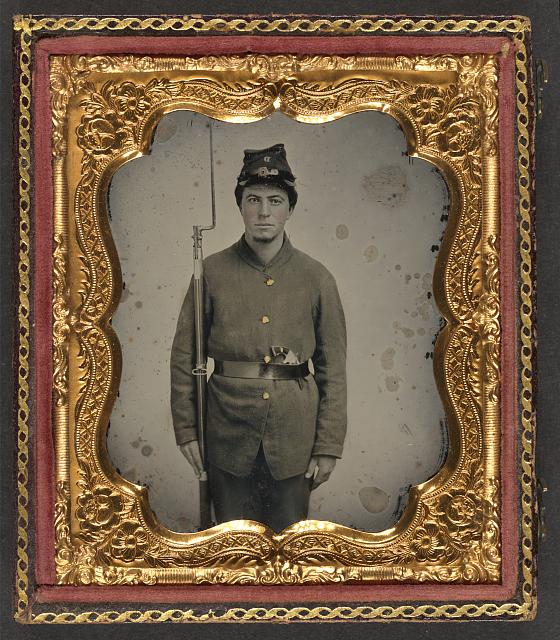 [Unidentified soldier in Union uniform and Company D forage cap with a bayoneted musket and revolver]