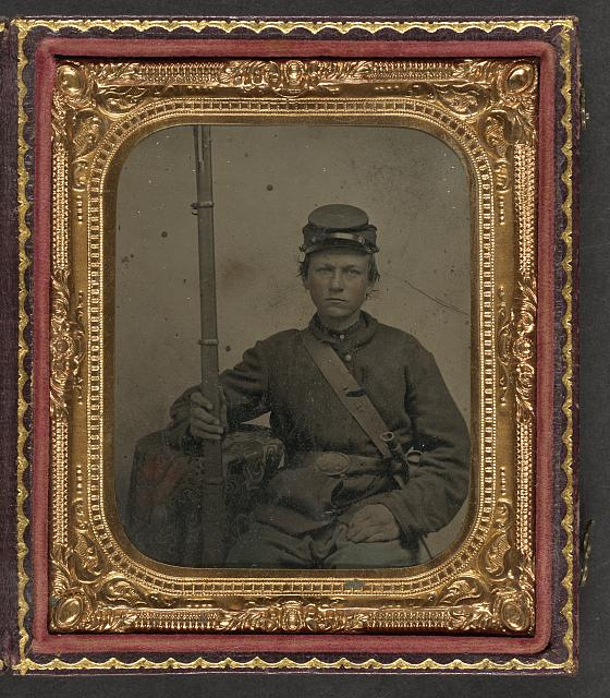 [Unidentified young soldier in Union uniform with musket and bayonet in scabbard]