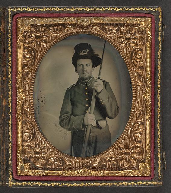 [Unidentified soldier in Union uniform and plumed infantry Hardee hat with bayoneted musket and cap box]
