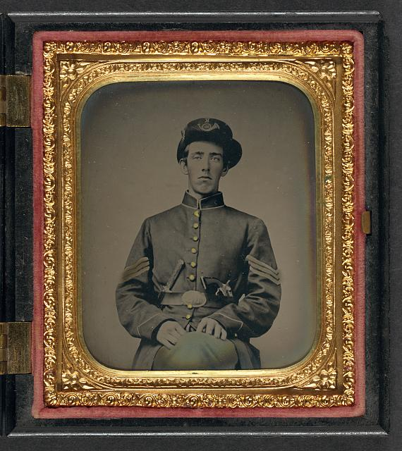 [Unidentified soldier in Union sergeant's uniform and Hardee hat with revolver and knife]