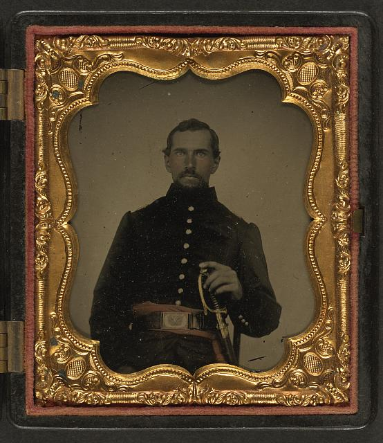 [Unidentified soldier in Union uniform with non-commissioned officer's sash and sword]