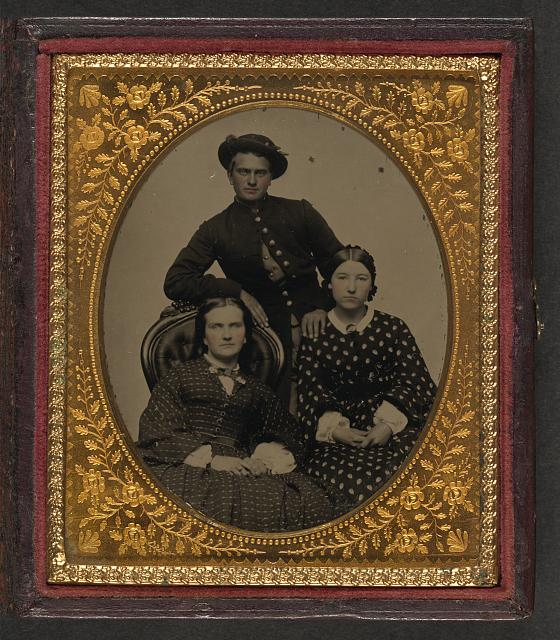 [Unidentified soldier in Union uniform and two women]