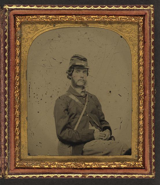 [Unidentified soldier in Union uniform and forage cap with canteen]