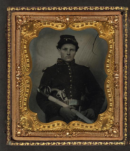[Unidentified soldier in Union uniform with dual revolvers and saber]