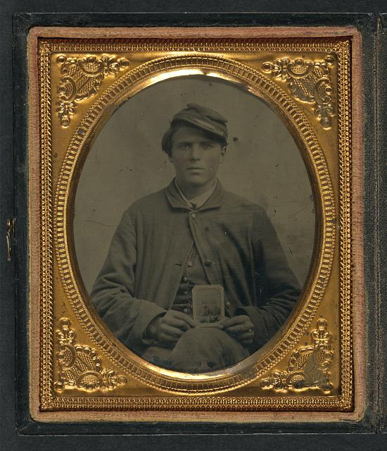 [Freeman Mason of Company K, 17th Vermont Infantry holding a tintype of his brother, Michael Mason, killed at Savage&#39;s Station, Virginia, in 1862]