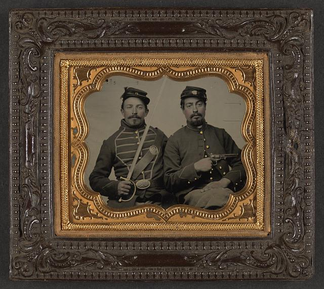 [Two unidentified soldiers in Union uniforms, one wearing musician's uniform and holding Model 1840 musician's sword, the other holding Colt Model 1851 Navy revolver]