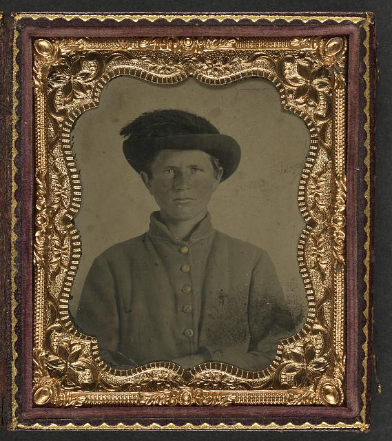 [Unidentified young soldier in Confederate uniform and slouch hat with plume]