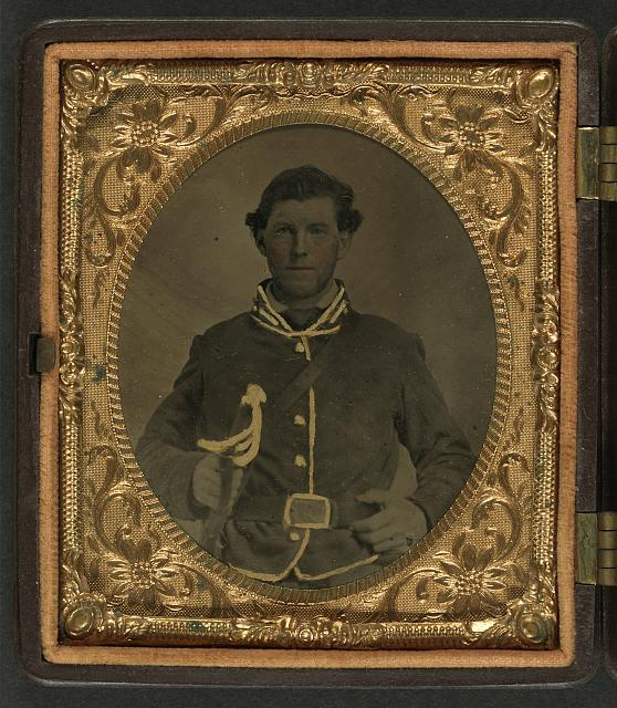 [Unidentified soldier in Confederate second lieutenant cavalry uniform with sheathed cavalry sword]
