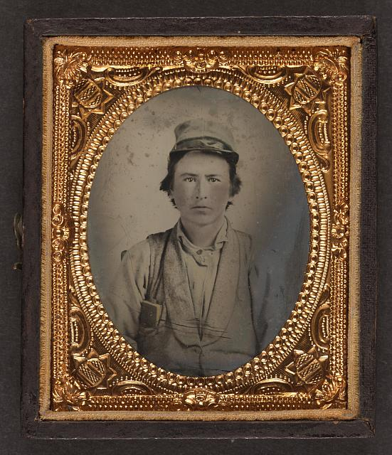 [Unidentified young soldier in Confederate kepi and vest with small book in pocket, possibly a Bible]