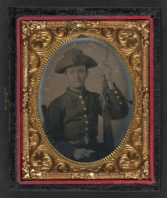 [Unidentified soldier in Confederate shell jacket and tricorn hat with first model Maynard carbine]