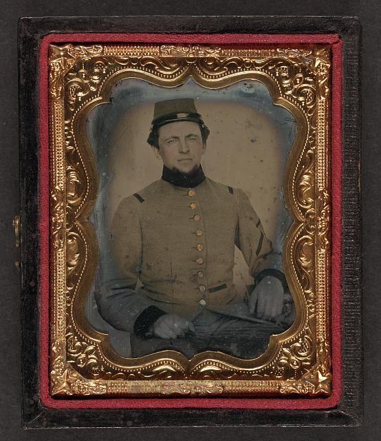 [Unidentified soldier in Confederate frock coat and kepi]