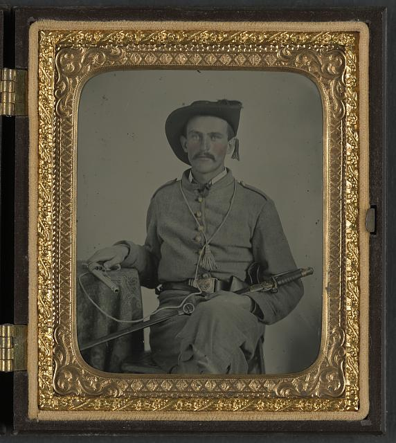 [Unidentified soldier in Maryland Confederate cavalry uniform with sword and pistol]