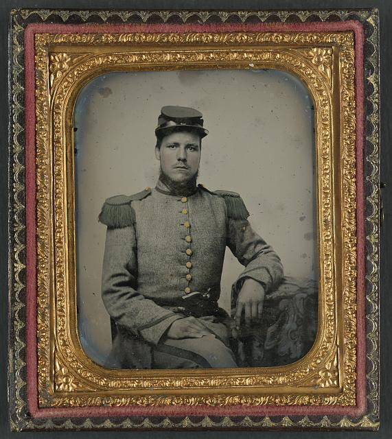 [Private Joseph T. Rowland of Co. A, 41st Virginia Infantry Regiment in uniform with epaulets and kepi with pistol in belt]