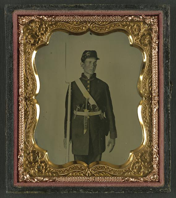 [Unidentified soldier in Union uniform with bayoneted rifle musket, Bowie knife, and two revolvers]