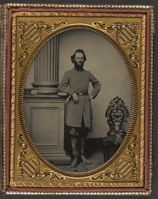 [Colonel Felix L. Price of Co. I, 14th Georgia Infantry Regiment, in uniform and CS buckle with books]