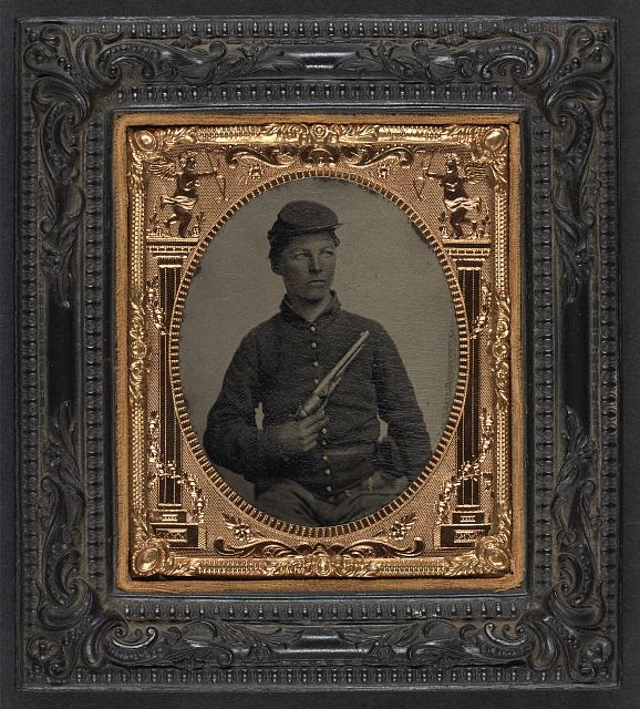 [Unidentified soldier in Union uniform with Colt Army Model 1860 revolver]