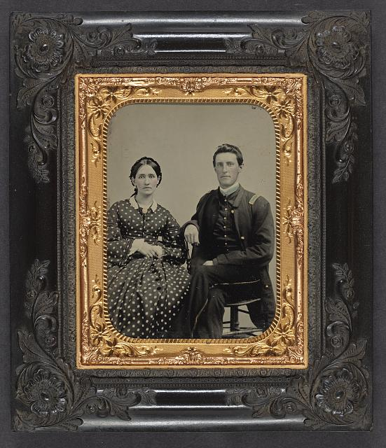 [Unidentified soldier in Union first lieutenant's uniform next to unidentified woman in dress]