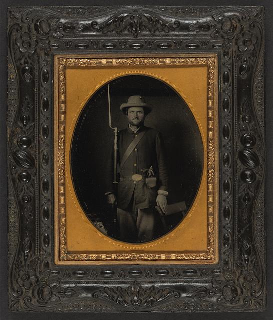 [Unidentified soldier in Union sack coat with holstered revolver and bayoneted musket]