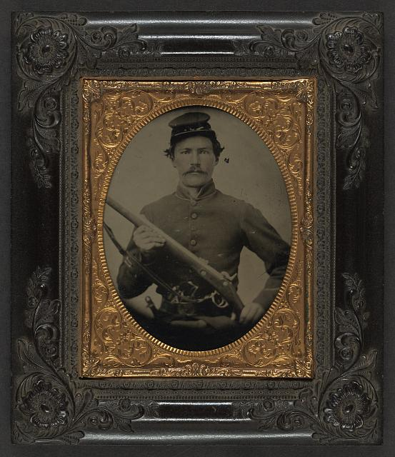 [Unidentified soldier in Union uniform with musket and revolver]
