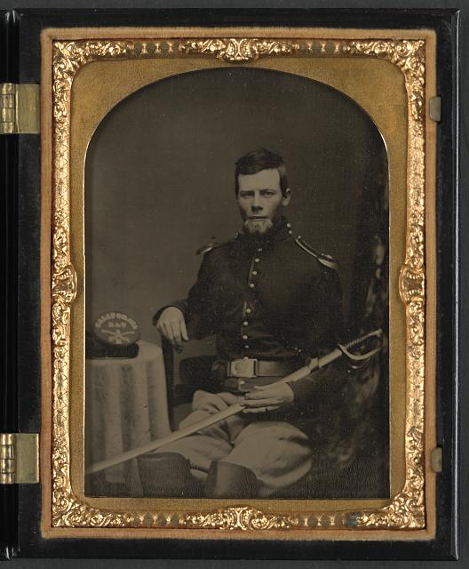 [Unidentified soldier in Union cavalry uniform with California Battalion hat and sword]