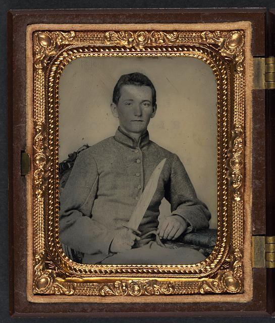 [Unidentified soldier in Confederate artillery uniform with large Bowie knife]