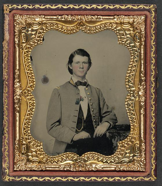 [Unidentified soldier in Confederate frock coat with gold trim]