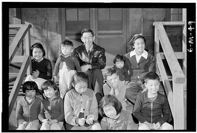 Mr. Matsumoto and children at children's garden, Manzanar Relocation Center, California