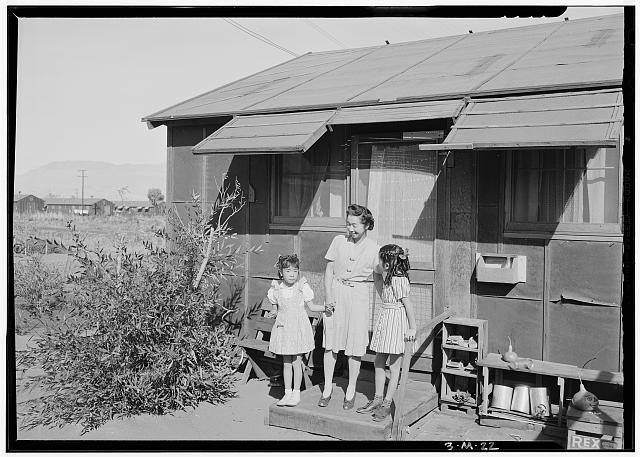 Mrs. Naguchi and two children, Manzanar Relocation Center
