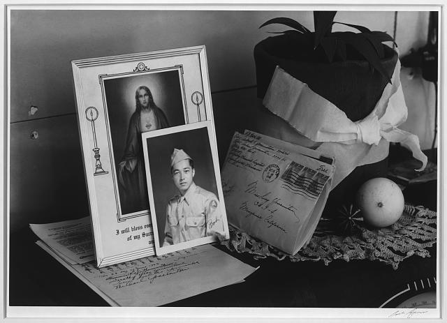 Pictures and mementoes on phonograph top: Yonemitsu home, Manzanar Relocation Center